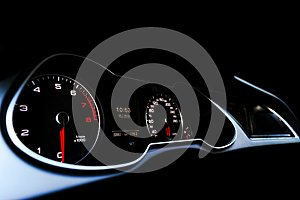 Close up shot of a speedometer in a car. Car dashboard. Dashboard details with indication lamps.Car instrument panel. Dashboard wi