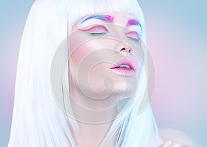 Beauty fashion model girl portrait with white hair, pink eyeliner, gradient lips. Futuristic makeup in white, blue and pink co