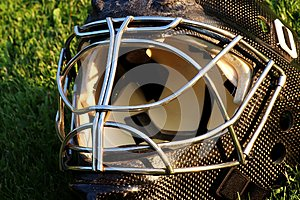 A goalie black helmet made from carbon material