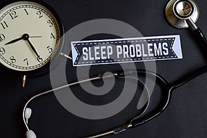 Sleep Problems on the paper with Healthcare Concept Inspiration. alarm clock, Black stethoscope.