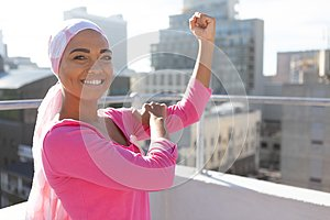 Strong woman in city with breast cancer awareness