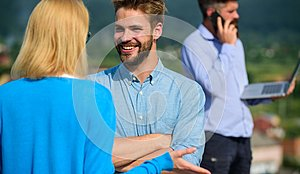 Couple having fun while busy businessman speak on phone. Couple happy flirting while man tense with mobile conversation