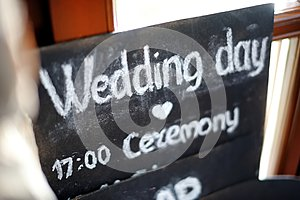 Blackboard with `Wedding day ` words written with white chalk