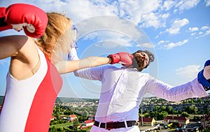 Let her win concept. Couple boxing gloves fight sky background. Girl confident strength power. Leadership family