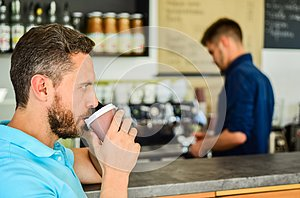 Man speak mobile phone and drink coffee cafe bar background. Traditional beginning of his day. Man solving problems