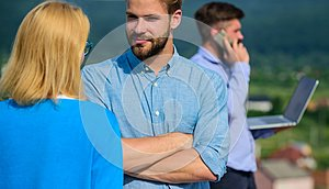 Couple having fun while busy businessman speak on phone. Couple flirting while man busy with mobile conversation. Flirt