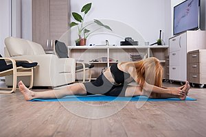 Attactive young woman being flexible during her home training