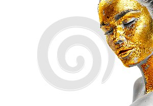 Fashion portrait of woman`s golden face closeup. Model girl with cracked gold foil on skin. Jewellery