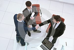 Top view.handshake business partners. the concept of cooperation.