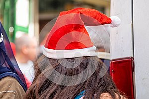 Undefined young woman wear santa hat