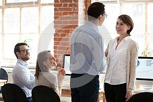 Male boss handshake female worker greeting with success
