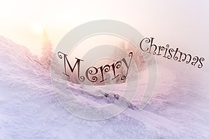 Christmas background with winter landscape in the mountains during sunrise/ Beautiful sunrise light
