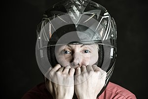 Danger and adrenaline are my name - portrait of a woman in a motorcycle helmet