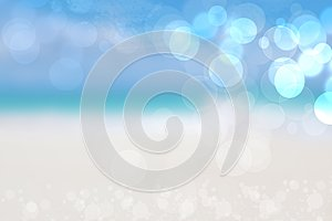 Abstract sea background. Abstract sandy summer beach background with bokeh lights on light blue sky. Beautiful texture. Space