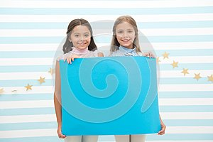 Your advertisement in good hands. Girls kids hold advertisement poster copy space. Children hold advertising banner