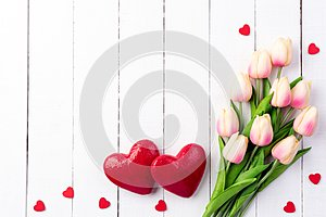 Valentines day and love concept. Two handmade red hearts with tulips