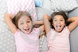 Having fun with best friend. Children playful cheerful mood having fun together. Pajama party and friendship. Sisters