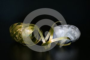 Curling Ribbon - Golden gift wrapping band on black background