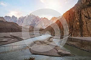 Landscape view of Hussaini hanging bridge above Hunza river, surrounded by mountains. Pakistan.