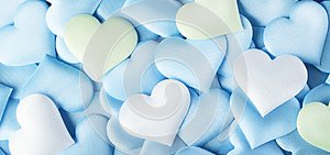 Valentine`s Day. Blue heart shape backdrop. Abstract Valentine background with blue, green and white pastel colors satin hearts