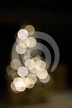 Abstract bokeh lights background in shape of Christmas tree