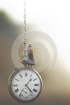 Surreal image of a business woman who travels under the control of fast-flowing time