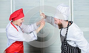 Couple compete in culinary arts. Kitchen rules. Who cook better. Culinary battle concept. Woman and bearded man culinary