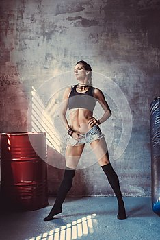 Fitness strength training workout concept - muscular bodybuilder sport girl doing exercises in gym