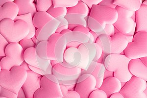 Valentine`s Day. Holiday abstract pink Valentine background with satin hearts. Love