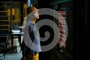 Hoi An / Vietnam, 11/11/2017: Female tourist standing in the dark wooden interior of a traditional house Tan Ky in Hoi An,