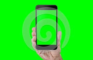 Hand showing phone with isolated screen and background in green