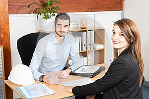 Attractive business people working in the office man and woman in business meeting