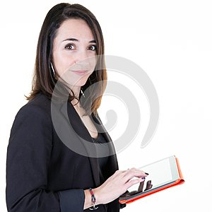 Young pretty businesswoman using tablet computer under white background