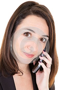 Beautiful businesswoman portrait having telephonic conversation with client talking on mobile phone