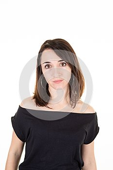 Pretty serious woman on a white background in classic portrait