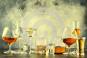 Selection of hard strong alcoholic drinks in big glasses and small shot glass in assortent: vodka, cognac, tequila, brandy and