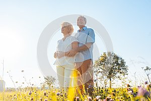 Romantic elderly couple enjoying health and nature in a sunny day of summer