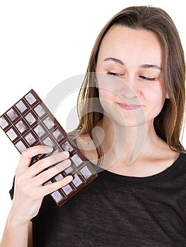Portrait of beautiful woman holding looking back chocolate bar