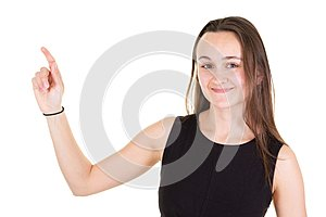Studio portrait of attractive young woman pointing side copyspace with finger