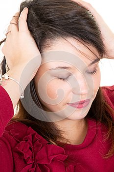 Young woman thinking and stressed hands on head