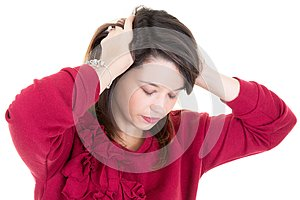 Young woman feeling stressed hands on head in white background