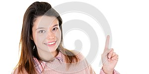 Happy young pretty woman pointing upwards