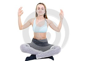 Young healthy woman doing yoga exercises isolated on white background