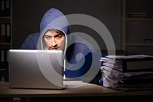 The thief trying to steal personal data in identity theft concept