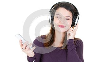 Young woman with headphones eyes closed and mobile phone