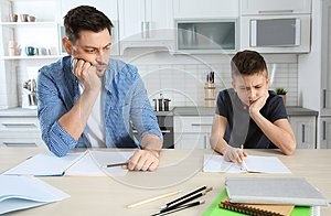 Dad helping his son with difficult homework assignment