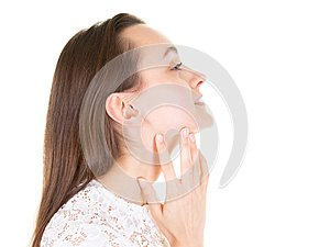 Gorgeous profile of young beauty woman with finger under chin thinking and closed eyes in copyspace over white studio background
