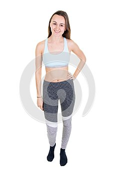 Full length beautiful fitness woman with perfect body wearing sport clothes for gym training girl