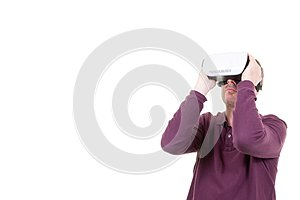 Man playing in virtual reality goggles in white background with copy space