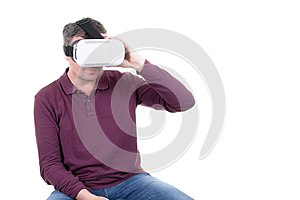 Closeup of male young man wearing virtual reality goggles smartphone using with VR headset in office Horizontal